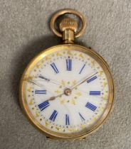 18ct gold cased ladies pocket watch, crown wind, with gilt and enamel face, small crack to glass,