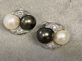 Pair of 18ct white gold and platinum Tahitian white and black pearl ear studs, with diamond accents,