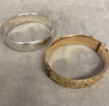 Sterling silver bangle together with a 9 ct gold plated example