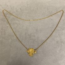 Unmarked yellow metal Chinese pendent on a 14ct gold ripe twist necklace, 22.5g