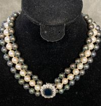 Triple strand of graduated Tahitian pearls of purple, green and white hues, largest pearl is 10mm