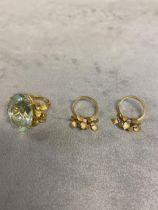 Unmarked yellow metal aqua/tourmaline marine and diamond dress ring, central oval free cut sapphire,