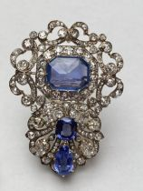 Late C19th/early C20th Sapphire and diamond brooch, set with 3 free cut sapphires, central untreated
