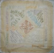 Cotton table cloth with intricate lacework borders and inset panels and over two hundred embroidered