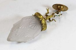 An early 20th century brass ceiling pendant light, with moulded frosted glass shade, h.35cmCondition