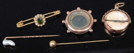 A 9ct gold cased Compass pendant together with a 9ct gold swivel pendant, two yellow metal tie