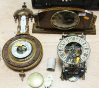 An early 20th century Continental carved beech barometer having a porcelain scale and enamelled