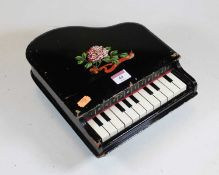 An early 20th century child's toy xylophone, in the form of a miniature grand piano, with floral and