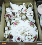 A collection of Royal Albert Old Country Roses chinaware, to include wall clock, clogs, stem vases