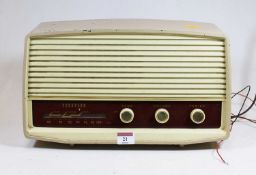 A 1950s Ferguson radio, housed in a beige painted metal case, w.37cmCondition report: See extra