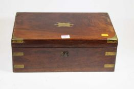A Victorian rosewood and brass mounted writing slope, the fitted interior with black leather inset