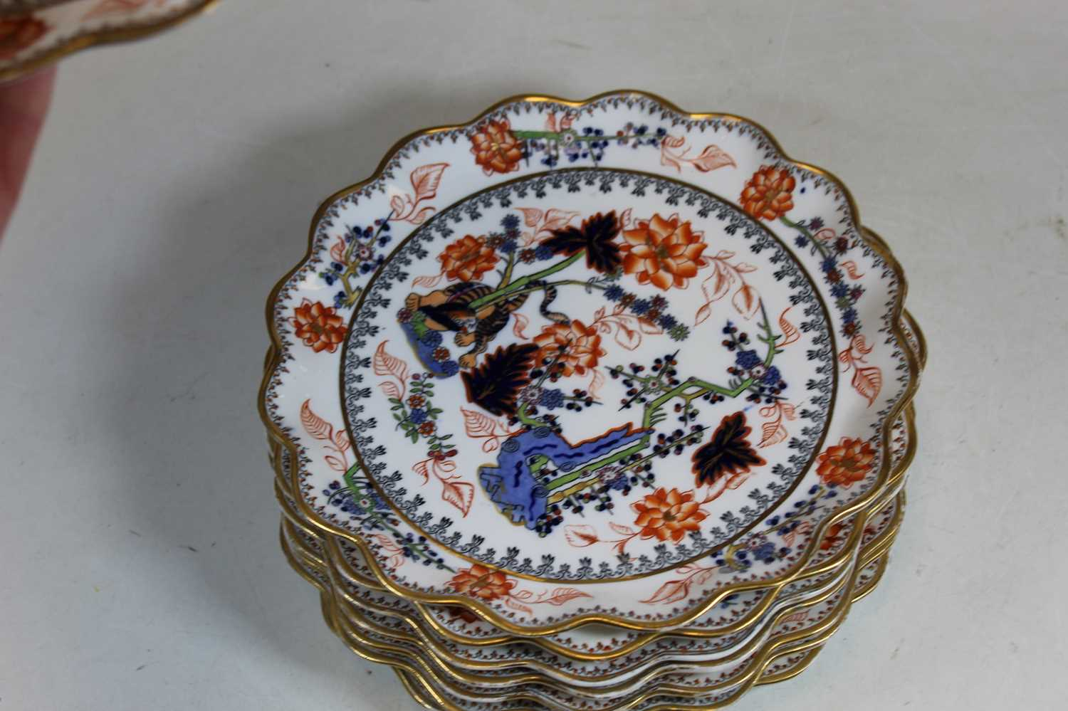 A 19th century Coalport part dessert service, decorated with a dragon amidst flowers and foliage, - Image 2 of 3