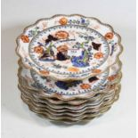 A 19th century Coalport part dessert service, decorated with a dragon amidst flowers and foliage,