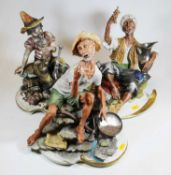 A Capo di Monte Naples pottery figure of a Gold Prospector, in seated pose, h.35cm; together with