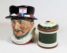 A Royal Doulton Beefeater character jug, h.17cm; together with a Devon pottery tobacco jar and cover