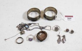 A small collection of miscellaneous items, to include a pair of silver napkin rings, carved shell
