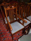 A set of six Edwardian walnut slatback dining chairs, each having blue upholstered drop-in pad seats