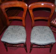 A set of four Victorian stained beech balloon back salon side chairs, with upholstered stuff over