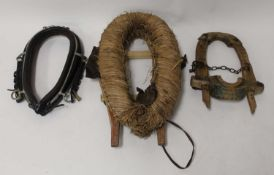 A black leather and steel horse-driving neck collar, 62cm; together with a straw covered heavy-horse