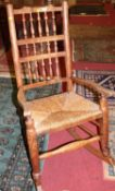 A 20th century stickback rocking chair in the Lancashire style