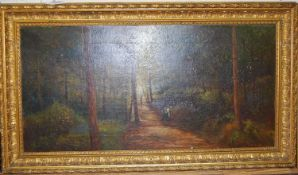 J Williamson - Figures on a woodland path, oil on canvas, signed lower right, 30 x 60cm