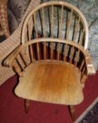 An elm seat and beech stickback Windsor chair, width 63cm