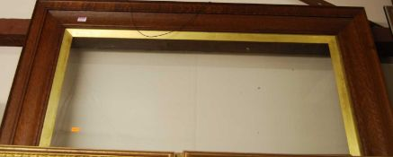 A late Victorian moulded oak picture frame, with giltwood inset slip, rebate dimensions 46 x 97cm