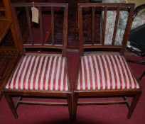 A pair of 19th century mahogany dining chairs, with striped upholstered drop-in pad seats