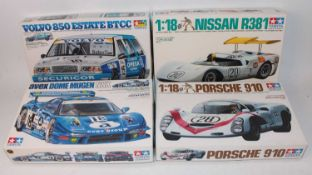 Four various boxed Tamiya 1/24 scale plastic race car kits to include an Avex Dome Mugn NSX race