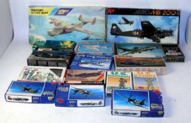 One box containing 21 various mixed scale plastic military aircraft and vehicle kits, mixed
