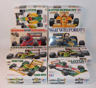Eight various boxed Tamiya 1/20 scale Formula One related plastic race car kits to include a Lotus