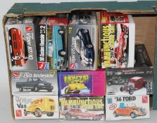 Ten various boxed Revell, AMT and Polar Lights 1/25 scale plastic sports car and race car kits to