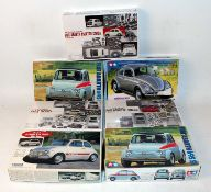 Seven various boxed Tamiya and Gunze Sangyo 1/24 scale plastic and white metal car kits to include a