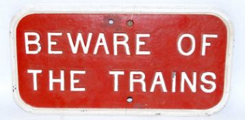 A small cast iron Southern Railway oblong white on red 'Beware of the Trains' warning