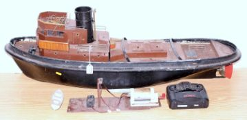 A wooden and GRP hulled part complete radio controlled operated tug boat, requires completion to