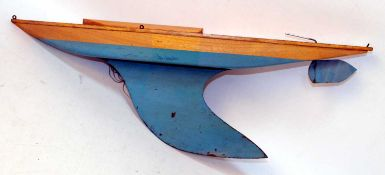 Bowman yacht hull without mast, with keel, with rudder, varnished above waterline, turquoise