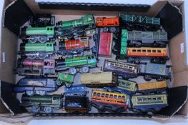 Large tray containing (mainly) British made lower value 0 gauge locos, coaches and wagons, Chad
