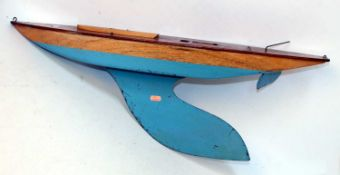 Bowman yacht hull without mast, with keel, varnished above waterline, turquoise below, with