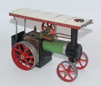 A Mamod steam tractor, would benefit from cleaning, appears to have been steamed corrosion spots