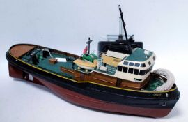 A wooden kit built, possibly Calder Craft, model of a Liverpool Crosby tug, finished in red and