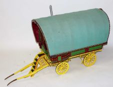 A very well made wooden and metal constructed model of a travelling caravan, approximately 2 inch