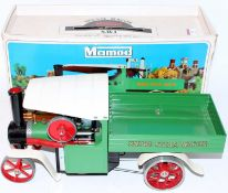 A Mamod SW1 steam wagon comprising of green, white and red body of usual specification, housed in