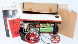 A Mamod TE1 traction engine of usual specification, finished in green, black, red and white,