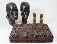 A pair of 20th century African carved hardwood portrait heads; together with a Chinese Imari palette