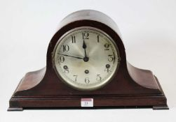 A 1920s mahogany cased mantel clock, having a silvered dial with Arabic numerals and eight day