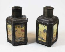 A near-pair of Chinese base metal tea canisters, each decorated with panels depicting erotic scenes,