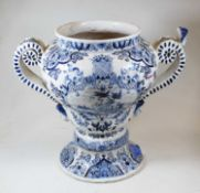 A late 18th century Dutch Delft urn, of baluster form flanked by twin scrolled handles, decorated