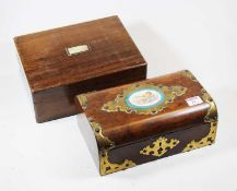 A Victorian walnut and brass mounted box, the hinged lid inset with an oval porcelain plaque