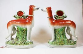 A pair of reproduction Staffordshire pottery models of greyhounds, 20th century, h.27cmCondition