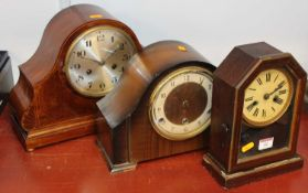 An early 20th century mahogany and boxwood strung 8-day mantel clock, the silvered dial showing